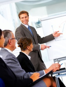 man-presenting-at-a-business-meeting1-226x300
